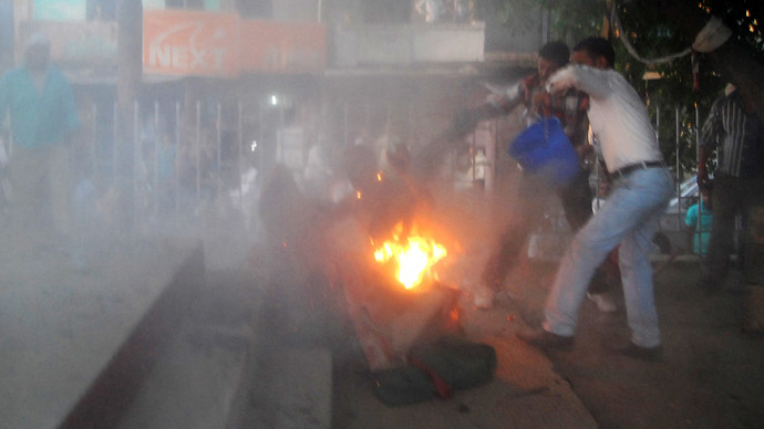 Horror show in India as debate spectator self-immolates, grabs politician