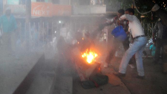 Horror show in India as debate spectator self-immolates, grabs politician