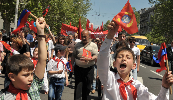 Armenian Pioneers, members a the youth Communist group, created in the Soviet Union for the 10-14-year-old children, parade in Yerevan, on May 1, 2014, during May Day celebrations (AFP Photo / Karen Minasyan)