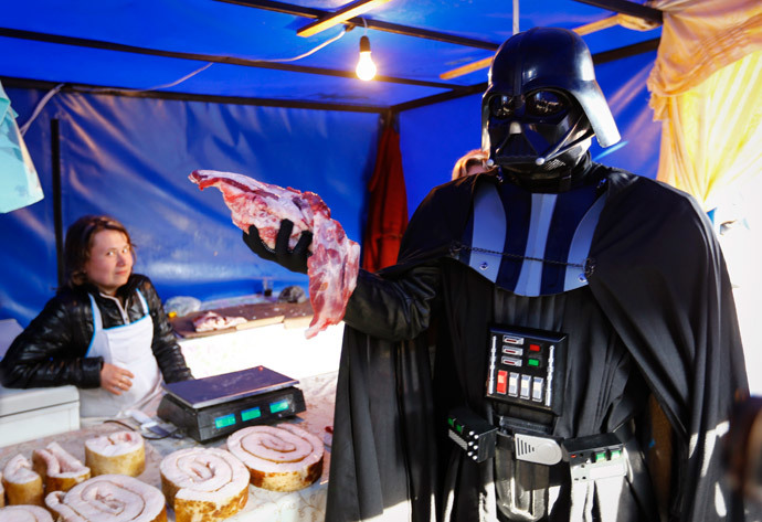 """Darth Vader"" holds a piece of meat at a street market in Kiev (Reuters / Shamil Zhumatov)"