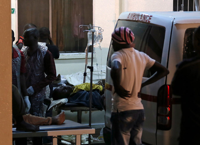 People who were injured during an explosion are taken into Asokoro General Hospital after arriving in ambulances, in Abuja May 1, 2014. (Reuters / Afolabi Sotunde)