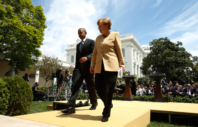 U.S. President Barack Obama and German Chancellor Angela Merkel walk from the Rose Garden after speaking to reporters about their earlier meeting at the White House in Washington May 2, 2014. (Reuters / Kevin Lamarque)