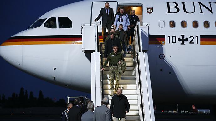 OSCE observers released in Slavyansk arrive in Berlin