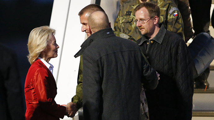 German Defence Minister Ursula von der Leyen (L) welcomes OSCE observers John Christensen (C) from Denmark Germany's Axel Schneider (2nd L) and unidentified observers in Berlin's Tegel airport, May 3, 2014. (Reuters / Fabrizio Bensch)
