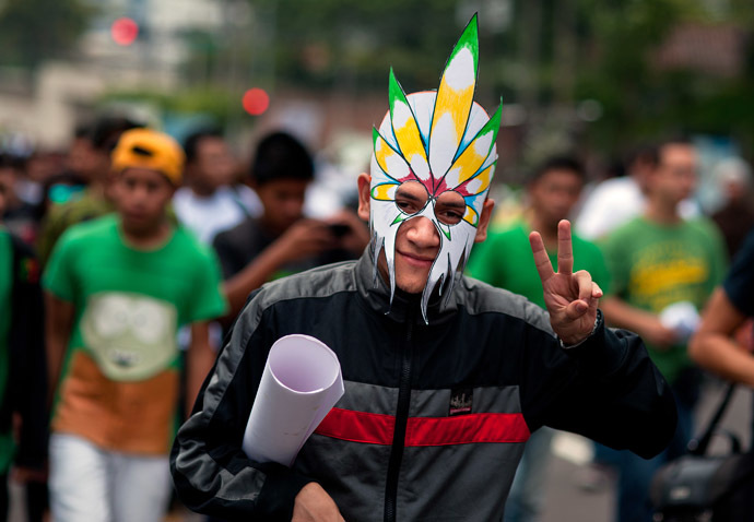 An activist gestures during a march demanding the legalization of marijuana in San Salvador, El Salvador on May 3, 2014. (AFP Photo/Jose Cabezas)