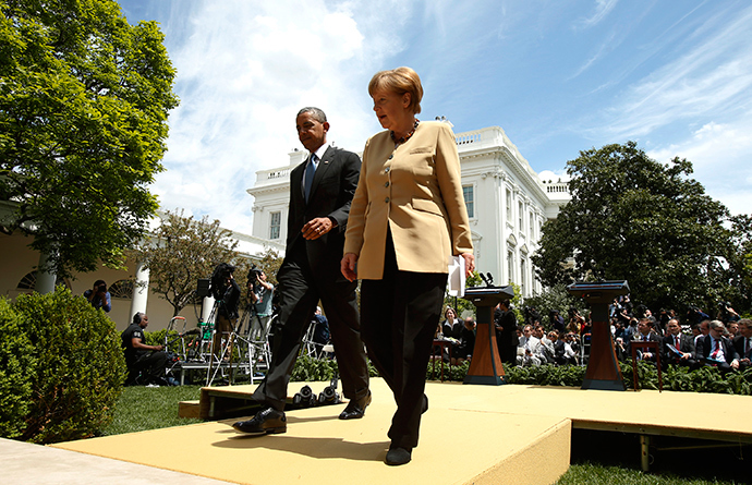 U.S. President Barack Obama and German Chancellor Angela Merkel walk from the Rose Garden after speaking to reporters about their earlier meeting at the White House in Washington May 2, 2014 (Reuters / Kevin Lamarque)