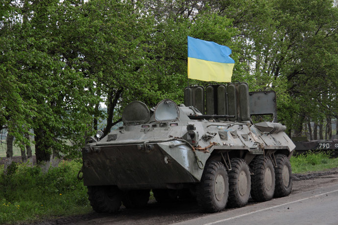 A Ukrainian flag flies on a armored military vehicle at a checkpoint near the eastern Ukrainian city of Slavyansk .(AFP Photo / Sergey Bobok )