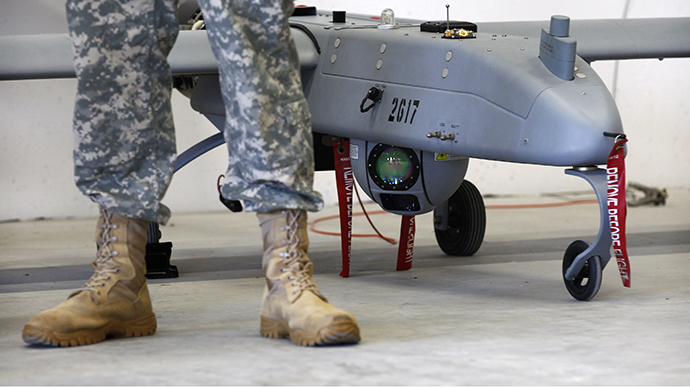 A soldier stands in front of a 'Shadow' drone during presentation by UAS at US military base in Vilseck-Grafenwoehr (Reuters / Michaela Rehle)