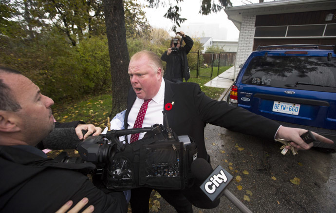 Toronto Mayor Rob Ford yells at reporters and photographers to get off of his property in front of his house in Toronto October 31, 2013. (Reuters/Mark Blinch)