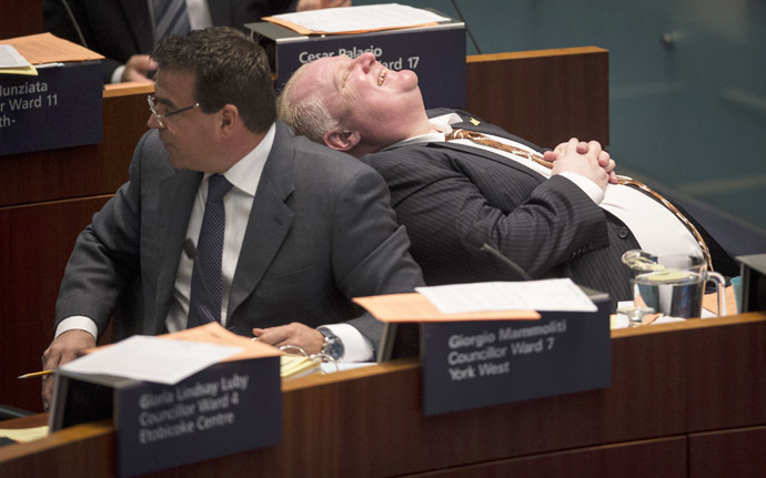 Toronto Mayor Rob Ford laughs during council beside councillor Giorgio Mammoliti at City Hall in Toronto, November 14, 2013. (Reuters/Mark Blinch)