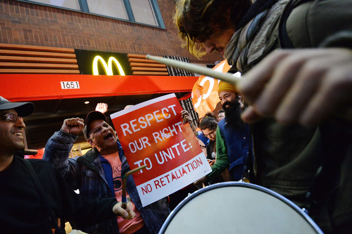 Demonstratorsoutside a McDonald's restaurant near New York's Times Square as part of a nationwide protest of fast food workers December 5, 2013. (AFP Photo / Stan Honda)