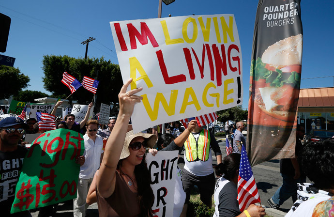 Workers and their supporters protest outside McDonald's as part of a nationwide strike by fast-food workers to call for wages of $15 an hour, in Los Angeles, California August 29, 2013. (Reuters / Lucy Nicholson)