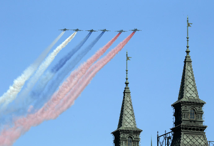 Russian military aircraft trail smoke in the colours of the Russian tricolor above the Victory Day Parade in Moscow's Red Square May 9, 2014. (Reuters)