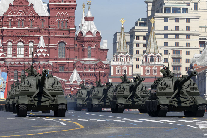 Russian servicemen onboard self-propelled artillery vehicles salute during the Victory Day Parade in Moscow's Red Square May 9, 2014. (Reuters)
