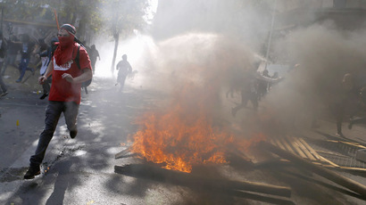 Chilean activist sets fire to $500 mn worth of student debt documents