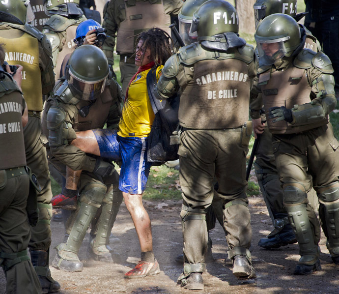 Riot police arrest a student who was taking part in a protest against the education system, in Santiago, on May 8, 2014. (AFP Photo)