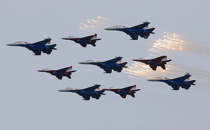 Planes from Russia's military aerobatics teams Strizhi (Swifts) and Russian Knights perform during events marking Victory Day in Sevastopol May 9, 2014. (Reuters/Maxim Shemetov)