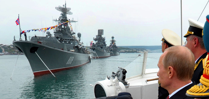Russia's President Vladimir Putin (R) reviews ships of Russian Black Sea fleet during a visit to the Crimean port of Sevastopol on May 9, 2014. (RIA Novosti/AFP/Alexey Druzhinin)