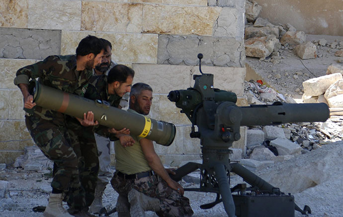 Rebel fighters prepare to launch an anti-tank missile towards forces loyal to Syria's President Bashar al-Assad in Maaret al-Naaman village, in Idlib April 30, 2014. (Reuters / Rasem Ghareeb)