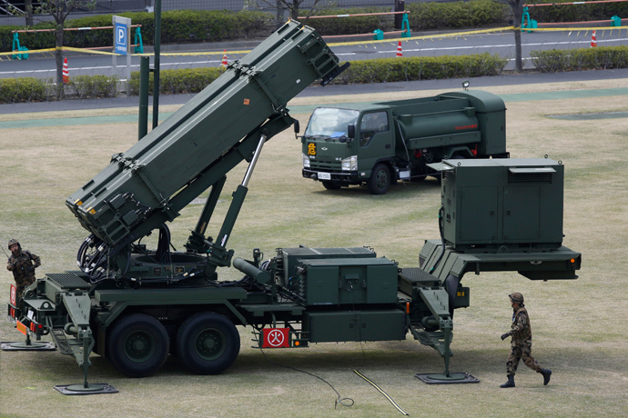 Japan Self-Defence Forces soldiers prepare to refuel a unit of Patriot Advanced Capability-3 (PAC-3) missiles (Reuters)