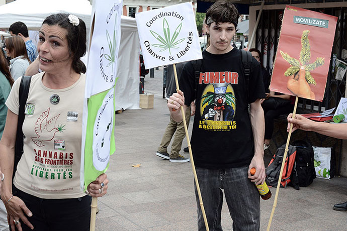 People hold signs reading ''Coordination hemp and freedoms'' during a protest to call for the legalization of marijuana on May 10, 2014 in Toulouse, southern France. (AFP Photo / Remy Gabalda)
