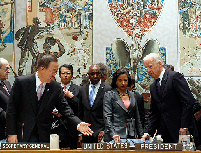 United States Vice President Joe Biden (R) sits with UN Secretary General Ban Ki-moon (L) as U.S. Ambassador to the UN Susan Rice stands (C) before the start of the United Nations Security Council High-Level Meeting on Iraq at U.N. headquarters in New York, December 15, 2010 (Reuters)