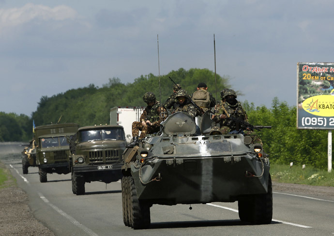 Ukrainian army armoured fighting vehicles and ambulances drive towards the eastern Ukrainian town of Slaviansk May 13, 2014. (Reuters/Yannis Behrakis)