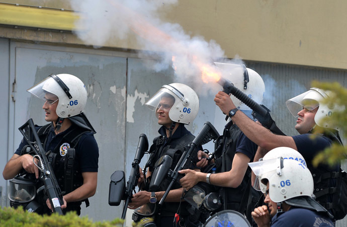 Riot police fire tear gas against protesters as they demonstrate to blame the ruling AK Party (AKP) government on the mining disaster in western Turkey, in Ankara May 14, 2014. (Reuters)