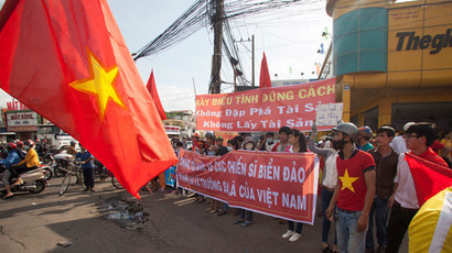 Amid riots, China blames Vietnam over disputed territory rift