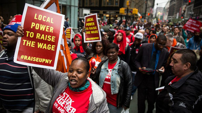 Protesters demanding higher wages for fast food workers chant during a massive rally on May 15, 2014 in New York City. (AFP Photo / Getty Images / Andrew Burton)