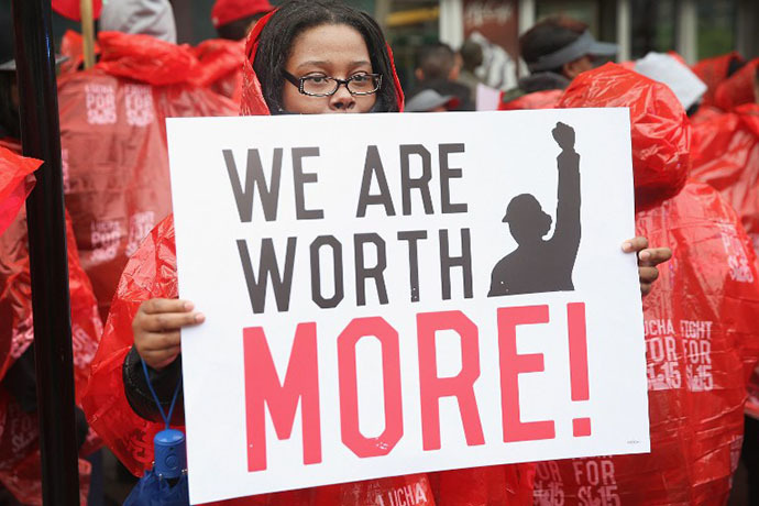 Fast food workers and activists demonstrate outside McDonald's downtown flagship restaurant on May 15, 2014 in Chicago, Illinois. (AFP Photo / Getty Images / Scott Olson)