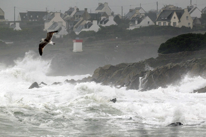 The sea batters the Brittany coastline near Plouhinec in Finistere as an Atlantic storm hits western France, January 1, 2014. (Reuters/Mal Langsdon)
