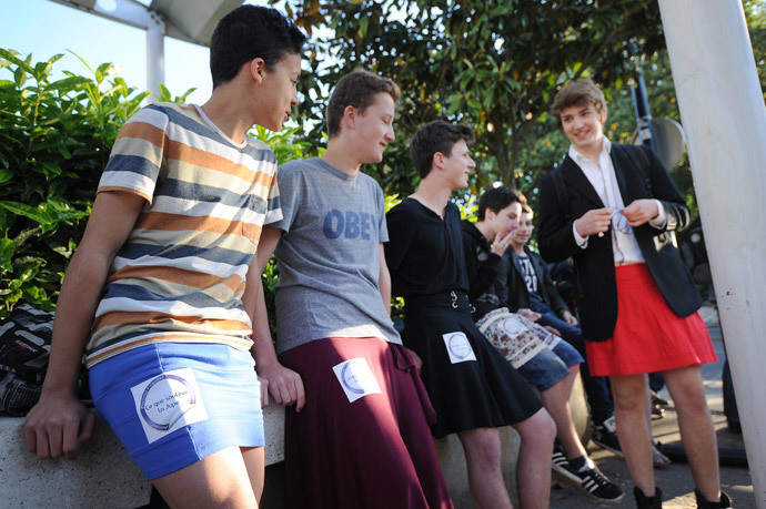 "Students dressed with a skirt as part of the so called ""Ce que souleve la jupe"" ( ""What raises the skirt?"") event in high schools wait, on May 16, 2014, in front of the Clemenceau high school in Nantes, western France. (AFP Photo / Jean-Sebastien Evrard )"