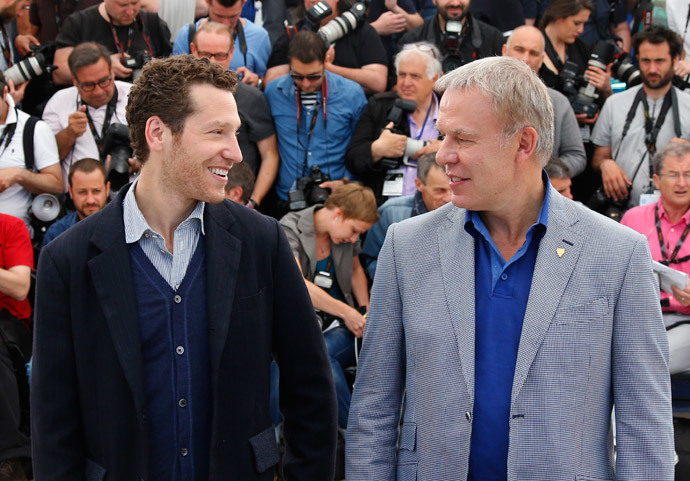 "Director Gabe Polsky (L) and Slava Fetisov, the former Captain of the Russian Red Army hockey team, pose during a photocall for the film ""Red Army"" out of competition at the 67th Cannes Film Festival in Cannes May 16, 2014.(Reuters / Yves Herman)"