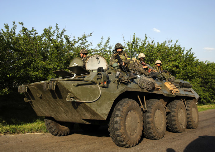 Ukrainian paratroopers ride atop an APC in the village of Starovarvarovka, southwest of the eastern Ukrainian town of Slavyansk May 15, 2014. (Reuters/Yannis Behrakis)