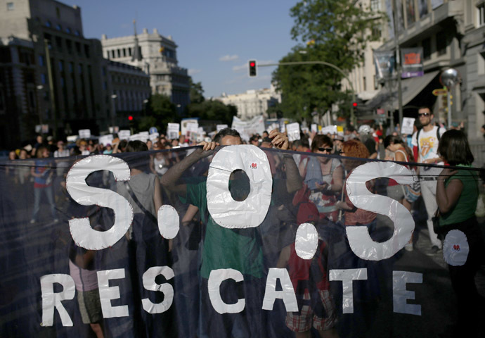 Demonstrators shout slogans, while arriving to the Puerta del Sol on the third anniversary of the 15M movement in central Madrid May 17, 2014. (Reuters/Javier Barbancho)