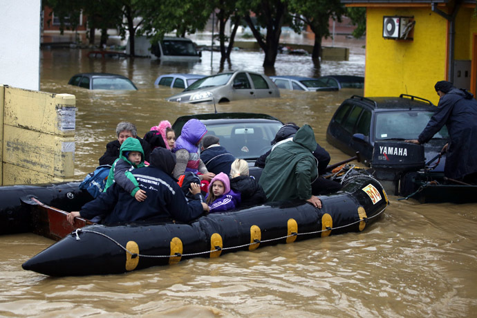 People evacuate in a boat in the flooded town of Obrenovac, southwest of Belgrade, Serbia May 17, 2014. (Reuters/Marko Djurica)