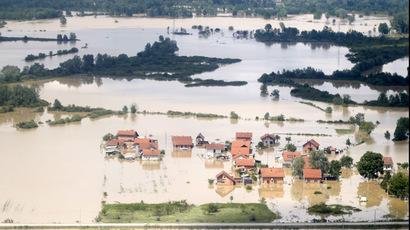 Inspiring images: People risk their lives saving animals from devastating Balkans flood
