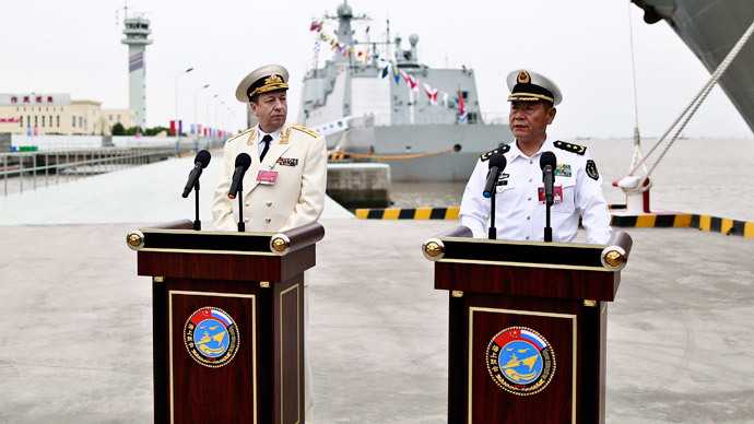 "Tian Zhong (R), deputy commander of the Chinese Navy and Alexander Fedotenkov, deputy commander-in-chief of Russian Navy, attend a news conference as directors of the upcoming ""Joint Sea-2014"" naval drill, at a port in Shanghai, May 18, 2014.(Reuters / China Daily)"