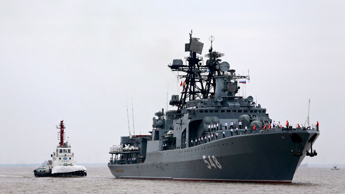 "Russian anti-submarine destroyer Admiral Panteleyev (R) arrives at a port ahead of the ""Joint Sea-2014"" naval drill, in Shanghai, May 18, 2014.(Reuters / China Daily)"