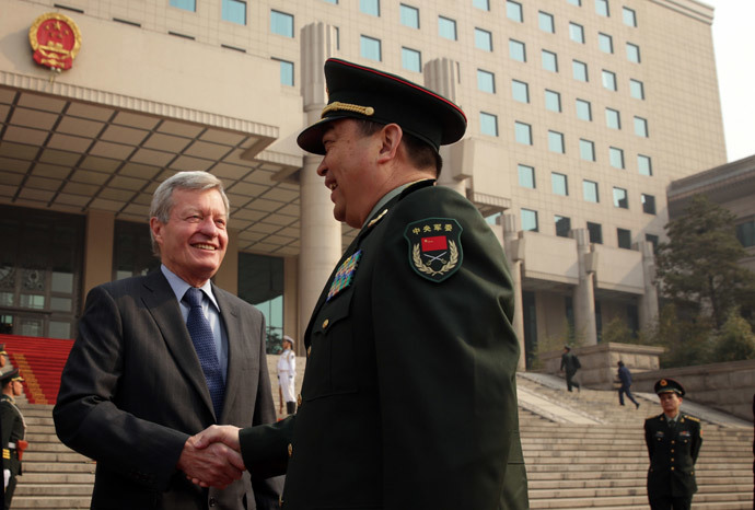 Chinese Minister of Defense Chang Wanquan (R) shakes hands with US Ambassador to China Max Baucus (L).( AFP Photo / Alex Wong )