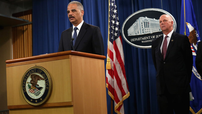 U.S. Attorney General Eric Holder (L) speaks as he announces indictments against Chinese military hackers on cyber-espionage as U.S. Attorney for Western District of Pennsylvania David Hickton (R) listens May 19, 2014 at the Department of Justice in Washington, DC.(AFP Photo / Alex Wong)
