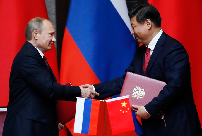 Russia's President Vladimir Putin (L) and China's President Xi Jinping shake hands after signing an agreement during a bilateral meeting at the Xijiao State Guesthouse ahead of the fourth Conference on Interaction and Confidence Building Measures in Asia (CICA) summit, in Shanghai May 20, 2014.(Reuters / Carlos Barria)