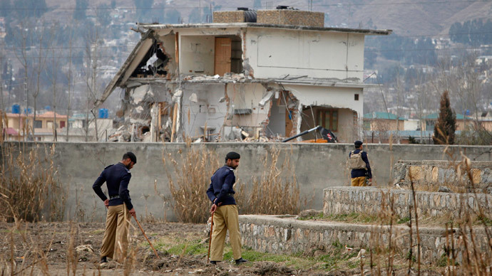Policemen stand guard near the partially demolished compound where al Qaeda leader Osama bin Laden was killed by U.S. special forces last May, in Abbottabad February 26, 2012. Pakistani forces began demolishing the house where Bin Laden was killed by U.S. special forces last May, in an unexplained move carried out in the dark of night. (Reuters / Faisal Mahmood)
