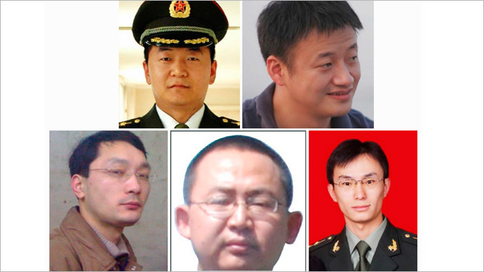 A combination photo shows five Chinese military officers who the U.S. has accused of cyber espionage. (Reuters/FBI)