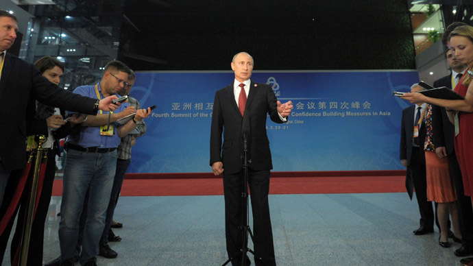 May 21, 2014. President Vladimir Putin talks to Russian journalists in Shanghai. (RIA Novosti/Alexei Druzhinin)