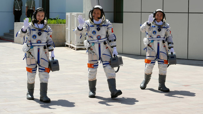 Chinese astronauts (from L to R) Wang Yaping, Nie Haisheng and Zhang Xiaoguang wave before leaving for the Shenzhou-10 manned spacecraft mission at Jiuquan satellite launch center in Jiuquan, Gansu province June 11, 2013.(Reuters / Stringer)