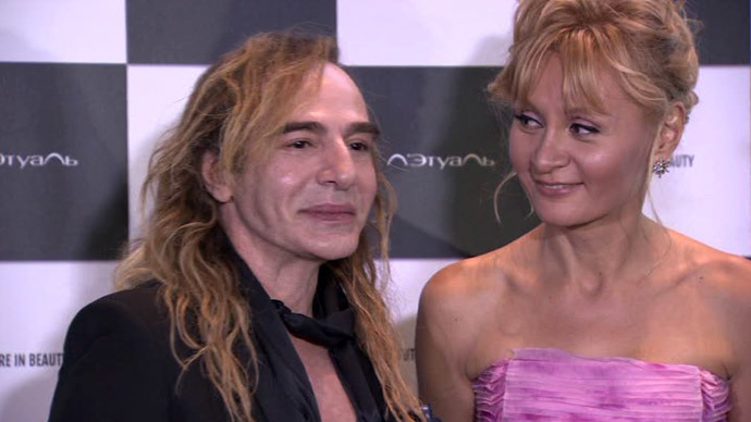 John Galliano with his new employer, L'Etoile general director Tatiana Volodina. Screenshot from RT video