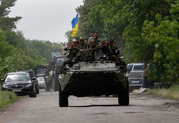 Ukrainian soldiers ride atop an armored personnel carrier, south of Donetsk (Reuters / Yannis Behrakis)