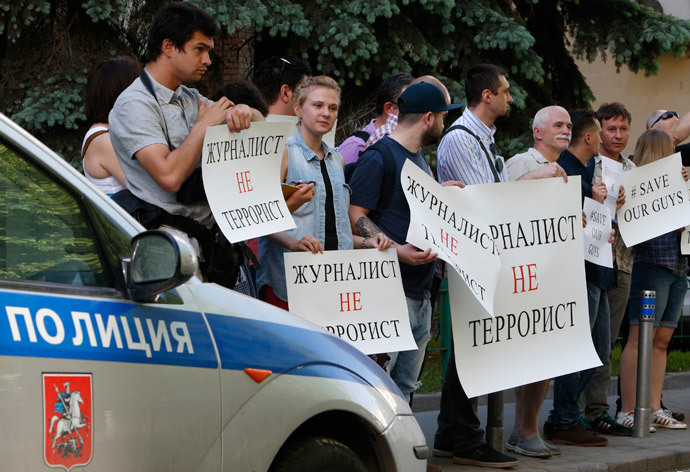 "Russian journalists hold placards during a protest outside the Ukrainian embassy in Moscow May 21, 2014. Placards read ""Journalists aren't terrorists"". (Reuters / Sergei Karpukhin)"